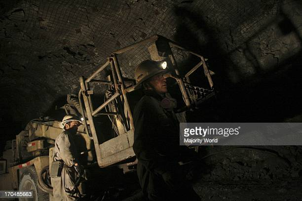 Two miners working in a mine Arequipa Peru April 3 2008