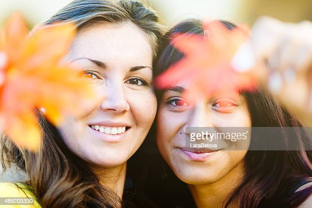 Two mixed race women in Autumn garden