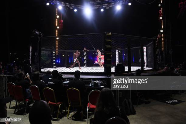 Two MMA's fighters compete during the Mixed Martial Arts league ARES in Dakar, on December 14, 2019.