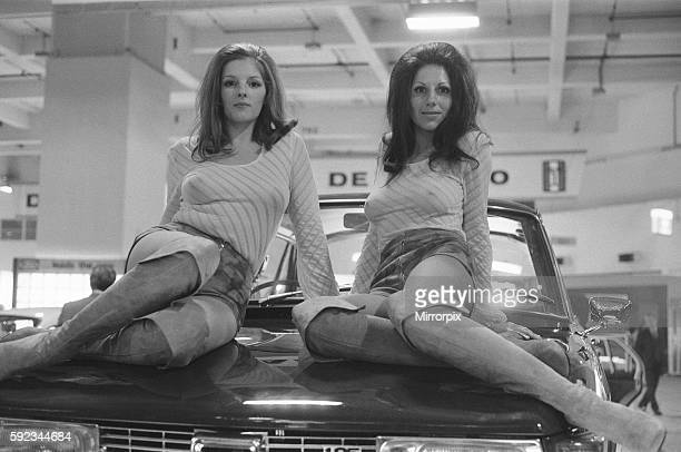 Two models draped over the bonnet of a car at the 1971 Earls Court motor show 19th October 1971