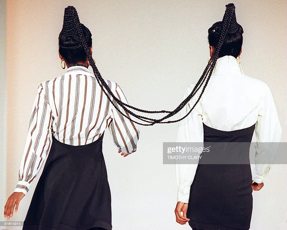 Two models have their hair braided together, 07 Ap : News Photo