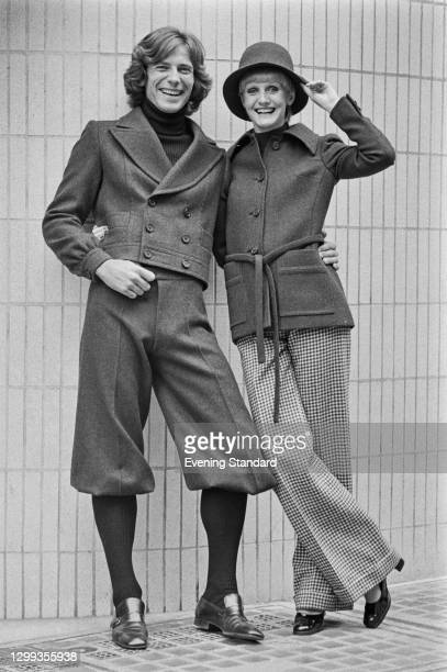 Two models in battledress jackets, knickerbockers and checked trousers from the Christian Dior autumn collection, UK, 5th September 1972.