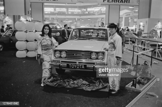 Two models in Japanese kimonos unveil the Toyota Corona 1600S Coupé at the 50th Earls Court Motor Show in London UK 19th October 1965