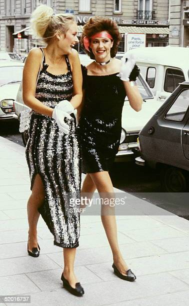 Two models of French fashion designer AndrT CourrFges have a walk in Paris street 02 April 1981 few days before his readytowear 1981/82 Fall/Winter...