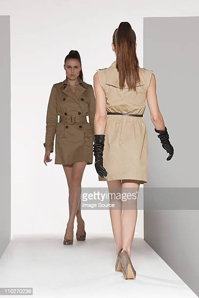 Two models on catwalk at fashion show