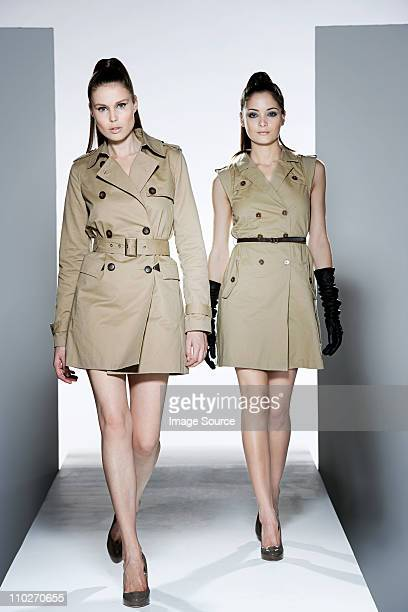two models on catwalk at fashion show - catwalk stock pictures, royalty-free photos & images