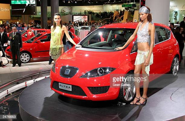 Two models show off the new SEAT Altea concept car at the Frankfurt Auto Show September 9 2003 in Frankfurt Germany Spanish carmaker SEAT is owned by...