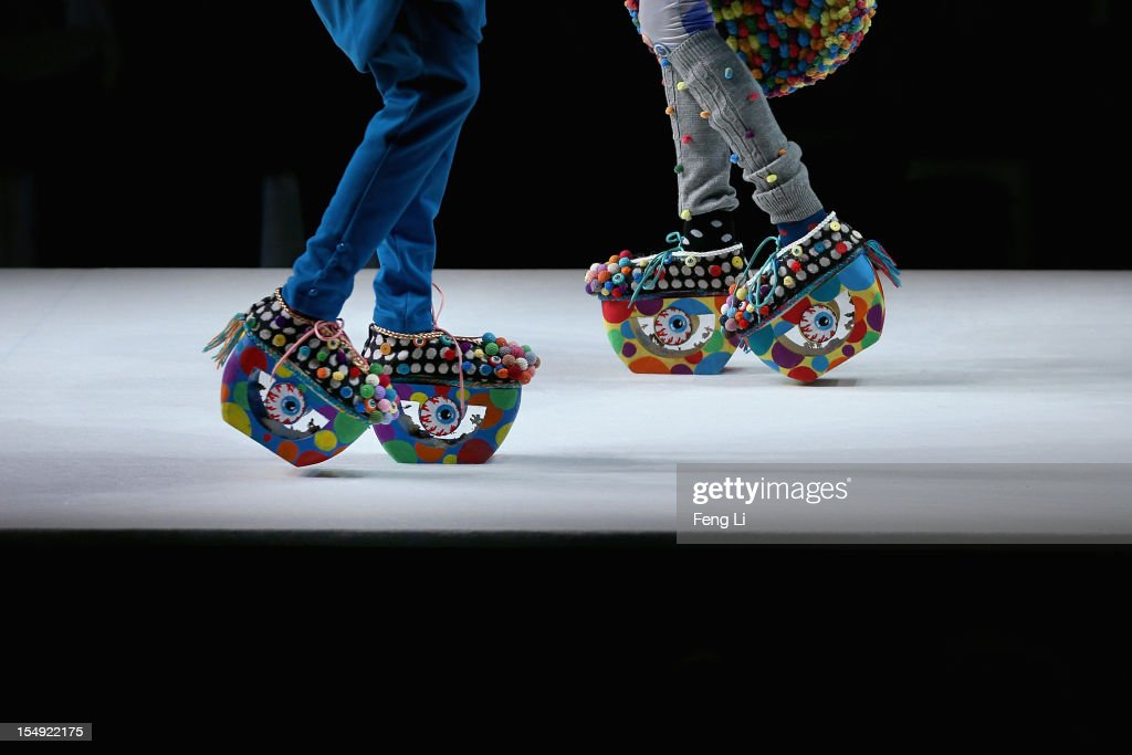 Two models showcase designs on the catwalk during the ESMOD Graduate Collection of China Fashion Week Spring/Summer 2013 on October 29, 2012 in Beijing, China.