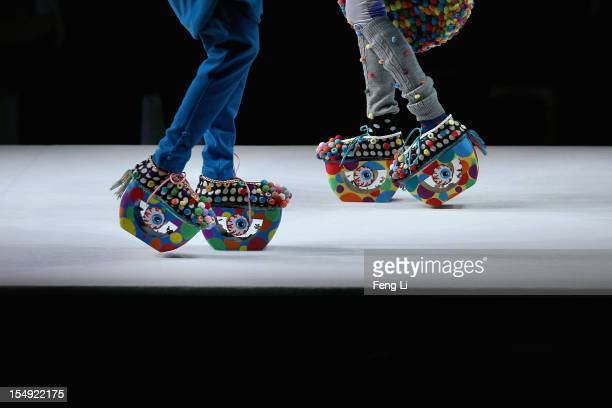 Two models showcase designs on the catwalk during the ESMOD Graduate Collection of China Fashion Week Spring/Summer 2013 on October 29, 2012 in...