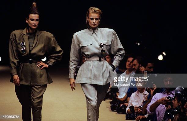 'Two models walk down the catwalk wearing dresses of the new Complice collection composed of horsewoman jacket and trousers Milan 1986 '