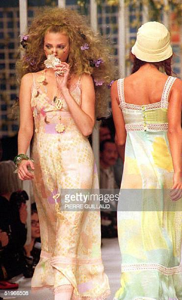 Two models wearing Chloe outfits pass each other on the runway at the 1993 Spring/Summer readytowear fashion show 14 October 1992 in Paris Pastel...