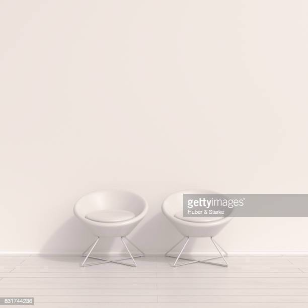 Two modern chairs in a waiting room