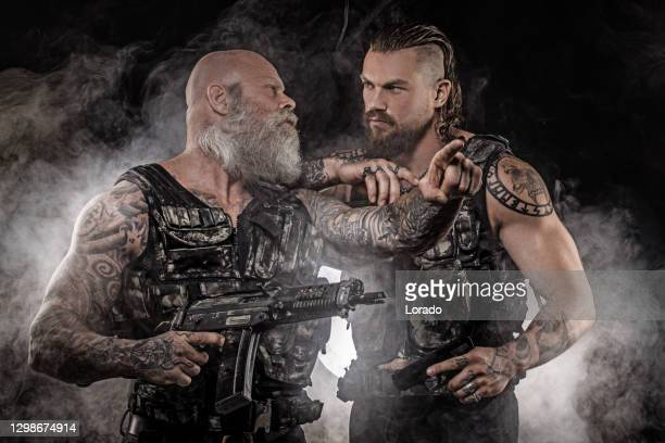 two modern urban warfare military soldiers in studio shoot - task force stock pictures, royalty-free photos & images