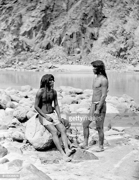 Two Mohave braves dressed in loincloths fulllength standing western Arizona 1871   Location western Arizona territory