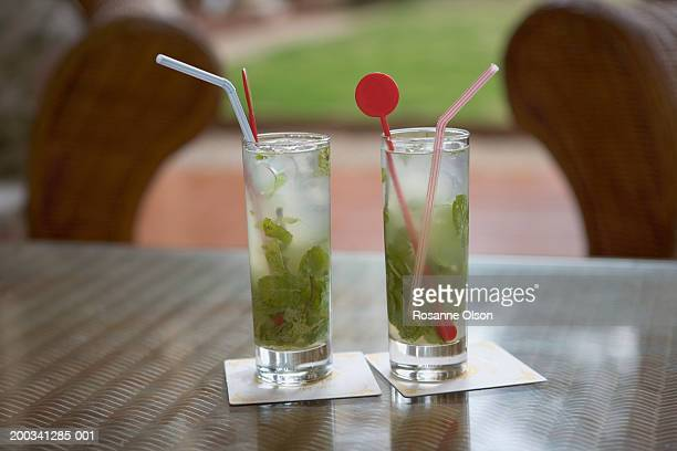 Two mojito drinks on outdoor table