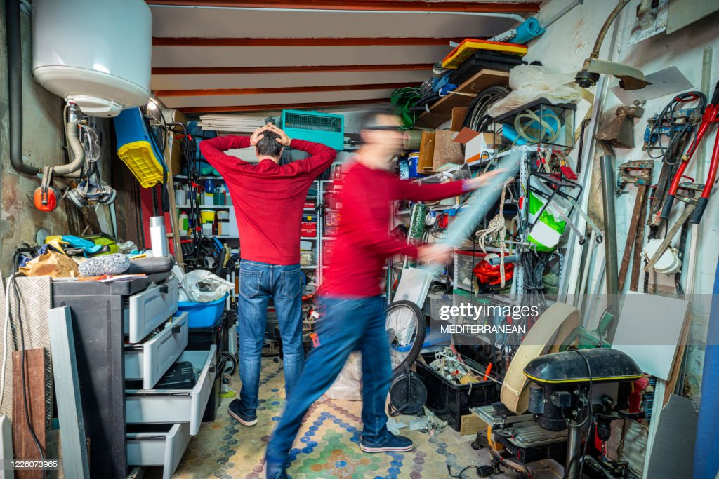 Two moments in the messy garage first amazed by chaos second begin to act and put order : Stock Photo