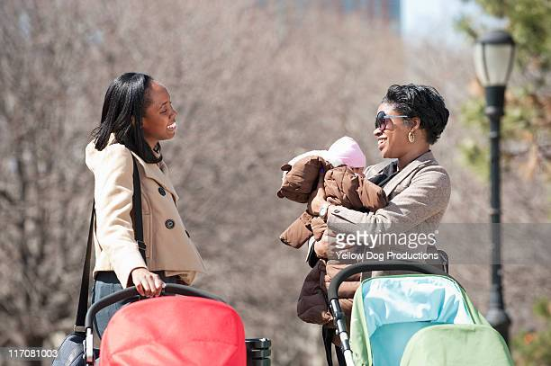 Two moms with babies and strollers
