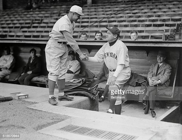 Two Monarchs of Swat Phila Pa Jimmy Foxx of the Phillies who last year hit more home runs than Babe Ruth did gets the congratulations of the Yankee's...