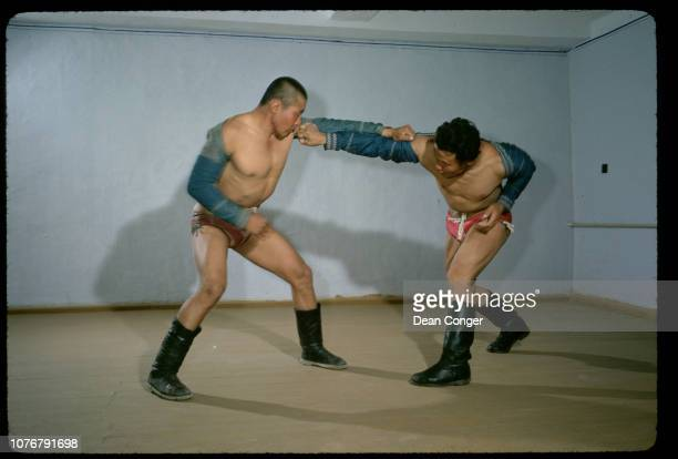 Two Mongolian Wrestlers Grappling