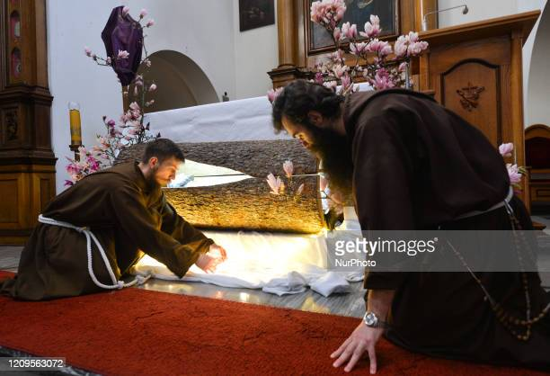 Two monks from the Order of Friars Minor Capuchins prepare the tomb of Christ inside the Cloister Church in Krakow On Thursday April 9 in Krakow...