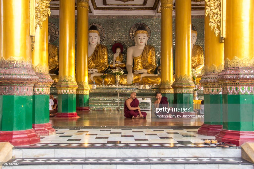 Two Monks Sitting In Prayer In A Temple In Shwedagon Pagoda