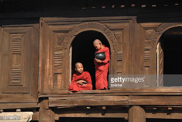 Two monks standing in windows