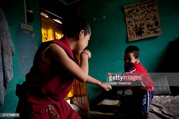 Two monks wrestle at a monastery in the Paljor Ling Refugee Camp in Pokhara Nepal is home to at least 20000 Tibetan refugees who often taking up...