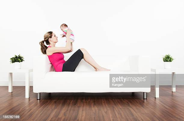 two month old baby and mother - happy new month stock photos and pictures