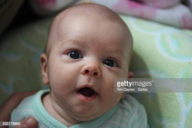 A two month old baby girl makes eye contact with the camera Photo Tim Clayton