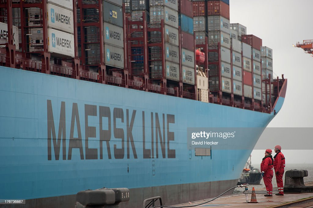 Two mooring men watch the world's biggest container ship, the Maersk MC-Kinney Moller as it arrives at the port of Bremerhaven on August 18, 2013 in Bremerhaven, Germany. The world's largest container ship, the Maersk MC-Kinney Moller, arrives at the port of Bremerhaven on Sunday. It has a length of 400 meters, it is 59 meters wide and is capable of delivering 18.000 TEU Container. The ship carries the first Triple-E Standard (Economy of Scale, Energy Efficiency, Environmentally-improved) and is the most efficient and energy saving container ship in the world.