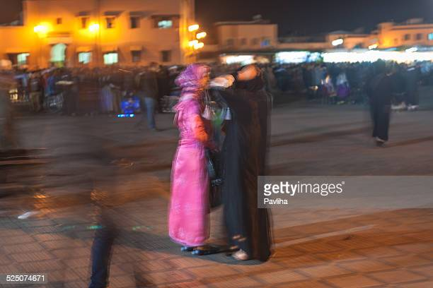 Two Moroccan Women Talking at Night Market, Marrakesh, North Africa