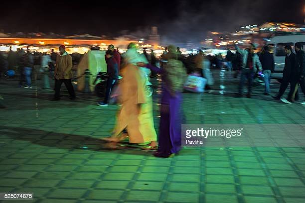 Two Moroccan Women Walking at Night Market, Marrakesh, North Africa