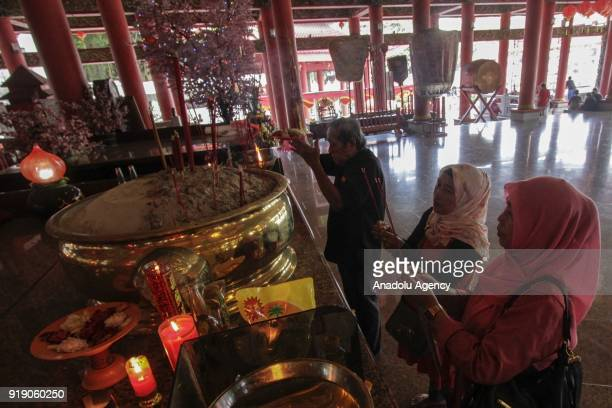 Two Moslem women are seen at a Lunar New Year celebration in the Sam Poo Kong temple in Semarang Central Java Indonesia on February 16 2018 The...