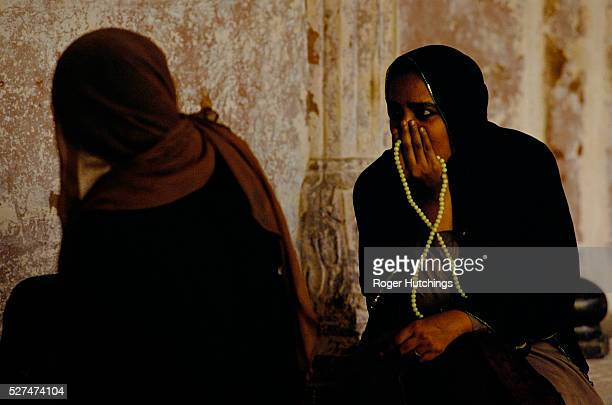 Two Moslem women at prayer in Jama Masjid mosque in the old quarter of the Northern Indian City DelhiThe mosque and its precincts are also called The...