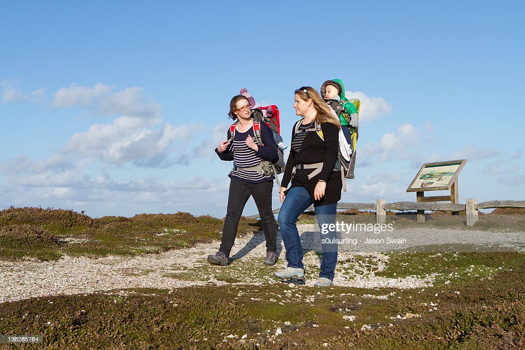 Two mother and baby walking on coastal : Stock Photo