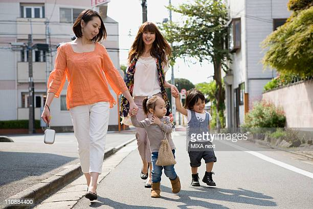 Two Mothers Walking Together with Children