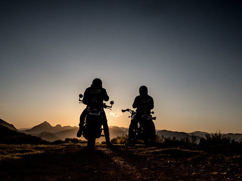 Two motorcycles and riders looking at the mountains - gettyimageskorea