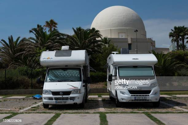 Two motorhomes are parked in a public parking in Castellon on July 4, 2020. - With social distancing now the new norm across Europe to avoid any...