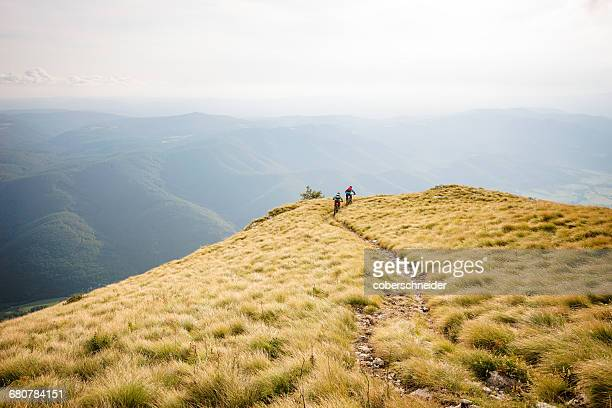 Two mountain bike riders on a trail near Vipava, Slovenia