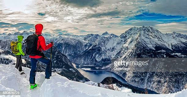 Two mountain climber look to Watzmann in Winter