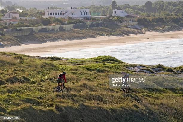 Two mountainbiker riding a single trail in Gargano, Apulia, Italy