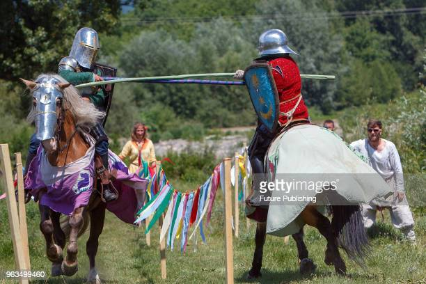 Two mounted history enthusiasts wield lances during a jousting event at the 7th Silver Tatosh International Festival of Medieval Culture Chynadiievo...