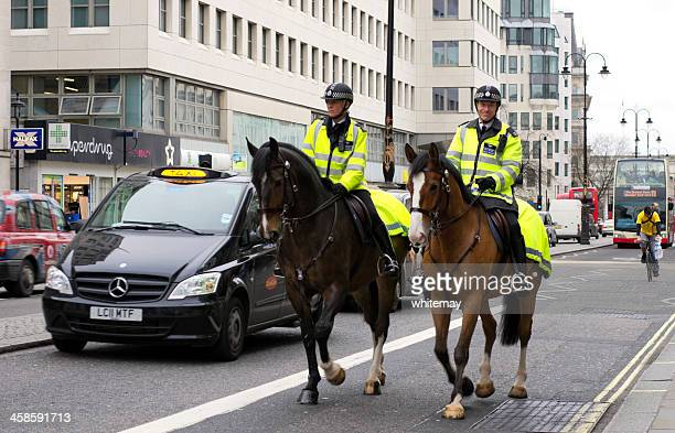 Two mounted Metropolitan Police officers, The Strand, London