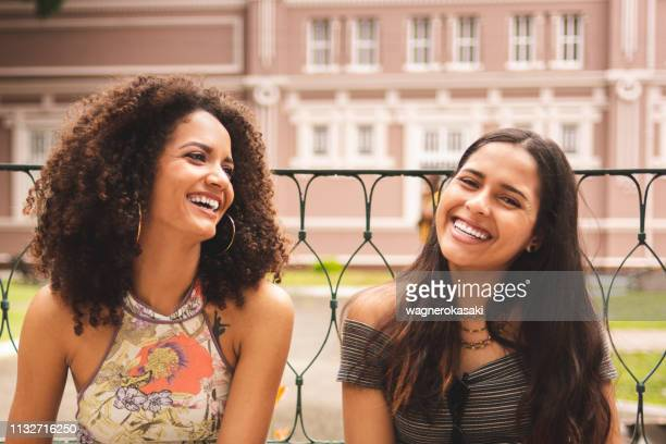 two multi ethnic young women having fun outdoors - para state stock pictures, royalty-free photos & images