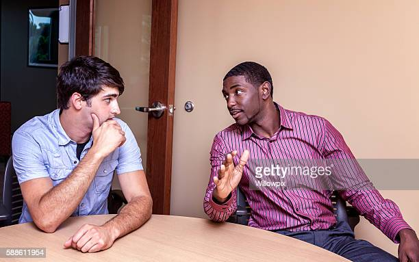 Two Multi-Ethnic Guys Conference Room Meeting Conversation