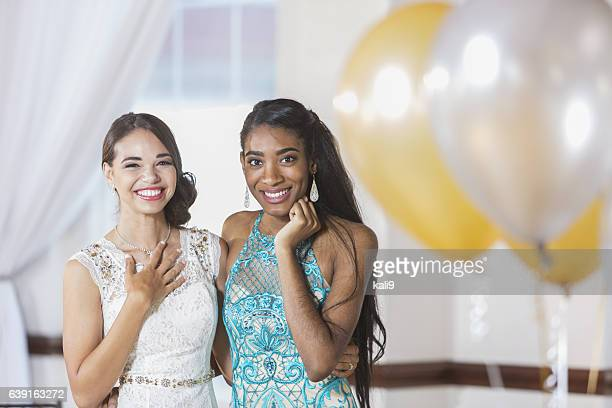 two multi-ethnic teenage girls dressed for special event - prom stock pictures, royalty-free photos & images