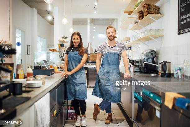 two  multiracial baristas in cafe kitchen - wait staff stock pictures, royalty-free photos & images