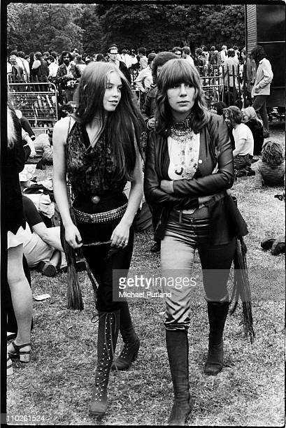 Two music fans dressed in late 1960s fashions in the audience at a Hyde Park music festival, London, 1969.