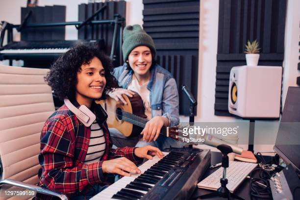two musicians having fun creating music - composer stock pictures, royalty-free photos & images