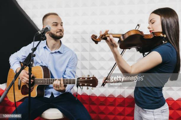two musicians in a recording studio - composer stock photos and pictures